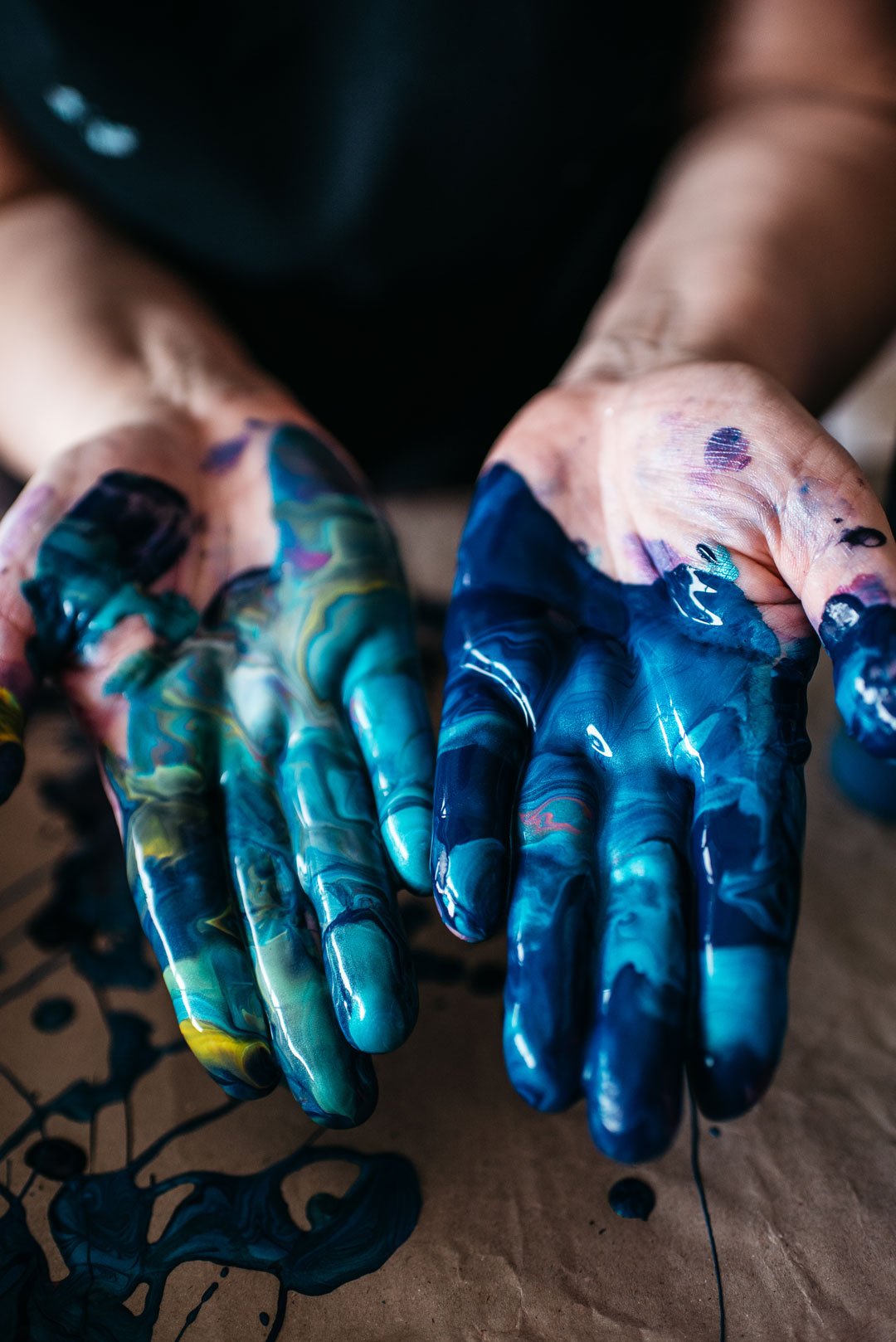 photo of hands in blue paint